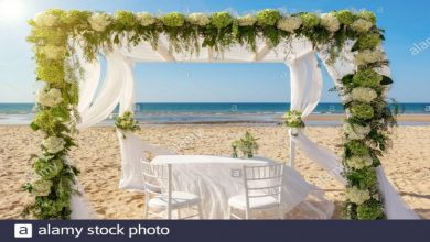 Photo of A wedding at the sea shore with wood flower